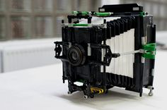 This DIY camera by Dominique Vankan caught our attention!    It's frankensteined together from Legos, an enlarger lens, duct tape, and cardboard.   via NotCot