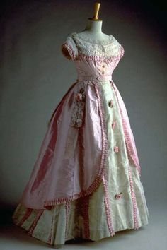Victorian Ball Gown Made Of Pink Satin, Lace, Ruffles, Ribbon And Crinoline     c. Late 1860's From Swiss National Museum