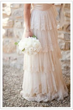 Lace tiered wedding dress.