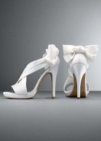"Glamorous White by Vera Wang satin platform sandal with pleated straps and bow back detail.  Satin platform sandal features delicate bow back detail and pleated straps.  Available in Blush, Ebony and Ivory.  Heel height: 4 3/4"". Platform: 1/4"".  Fully lined. Back zipper. Imported."