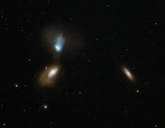 The most prominent characters are the two galaxies on the left — 2MASX J16133219+5103436 at the bottom, and its blue-tinted companion SDSS J...