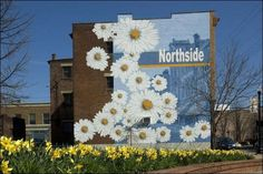 """The mural """"Northside Bloom"""" was painted in 2007 at 4119 Hamilton Ave. in Northside. See more local murals in our gallery."""