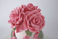 How to make gum paste roses on http://cakejournal.com/tutorials/how-to-make-gum-paste-roses/