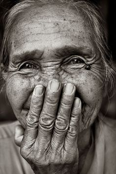 to capture a person truly is art in its highest form. Old lady, woman, female, oldie, aged, wrinckles, hands, fingers, face, sparkle in her eyes, portrait, a face that have lived a life, portrait, photograph, photo b/w.