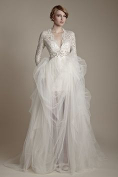 Lovely long sleeved winter wedding dress with tulle and lace.