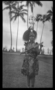 Portrait of woman wearing traditional Samoan dress and headdress. Creator/Contributor: Lambert, Sylvester Maxwell, 1882-1947, Photographer Date:between 1919 and 1939 Contributing Institution: UC San Diego, Mandeville Special Collections Library