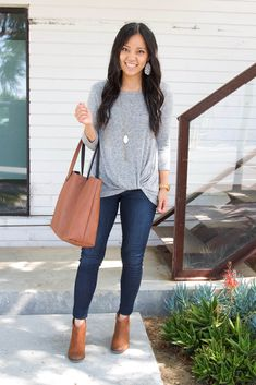 grey twist top + denim skinny jeans + cognac booties + cognac tote