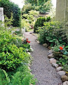 Edge It        When using loose materials, such as gravel or mulch, for your paths, an edging keeps your path from spilling into your beds and borders, lawn, or driveway. Here, stones do the job nicely.
