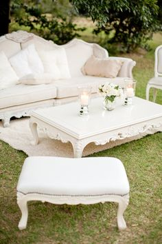 Bring indoor furniture onto the lawn - French style chairs, a sofa, and a coffee table.