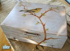 Bird painted on old silverware chest.