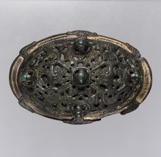 Oval Brooch, 900–1000 CE.   Copper alloy with gilding.  In the Metropolitan Museum of Art, New York.