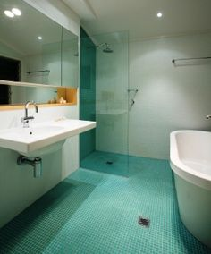 gorgeous contemporary wet room bathroom with turquoise tiles