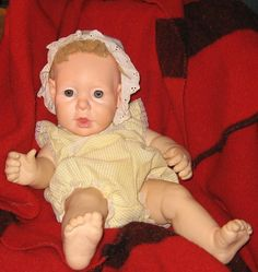 had this doll too/pretty heavy doll (weighted to feel like a real baby)