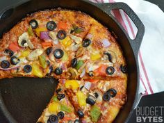 No knead pizza dough makes this hearty Chicago style pan pizza a breeze! Budgetbytes.com