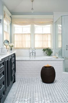 Love this clean, classic bathroom-especially the black and white tile.