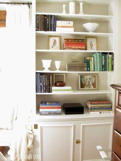 http://cottageandvine.blogspot.com/  bookshelf styling, Worldly Gray backs, trim detail added to cabinets for custom look