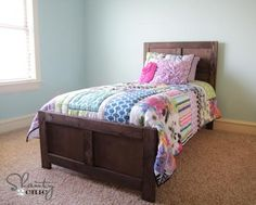Free plans to build a wood bed inspired by Pottery Barn Kids Emmett Bed for just $70. Step by step plans from Ana-White.com