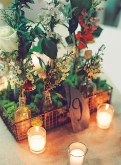 centerpiece in wire baskets, photo by Cassidy Carson Photography http://ruffledblog.com/the-2nd-notwedding-nashville #centerpieces #tablenumbers