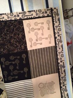 I found this perfect ribbon at Michael's to use as edge pieces on the steampunk quilt, and added a bit of crocheted black lace at the seams. Almost done!