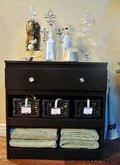 Guest bedroom dresser. Guests don't need three drawers so remove two and use to store towels and toiletries.