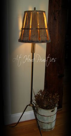 This 1/2 bushel basket worked great for this old pull chain floor lamp by At Home Primitives.