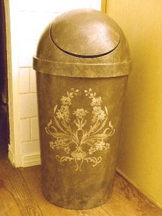 Paint a plastic trash can ... i have got to do this for the kitchen