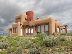 An off the grid home in the middle of nowhere... love the soft organic shapes that still lend to bold structural expression! architects, houses, desert, dream hous, grid, adob, homes, sweet home, straws