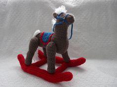 Stuffed crochet rocking horse.