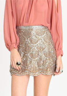 flashy skirt with a sheer top