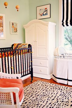 I hate nurseries that are blatantly pink or blue. Love how it's mostly black and white with mint green walls and orange pops of color!
