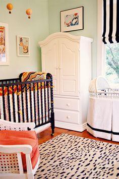 love the orange in this nursery