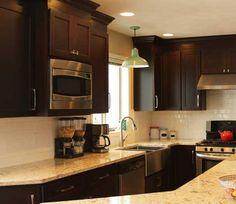 Kitchens dark brown on pinterest new construction for Bathroom remodeling lansing mi
