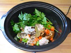 slow cooker chicken broth-Make an effortless and fully flavored chicken broth in your slow cooker using a leftover chicken carcass, vegetable scraps, and a couple herbs and spices.