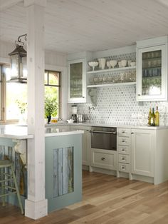 Love the lantern, the back splash that goes all the way up, and the collection of dishes on the shelves!