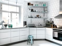 When trying to sell your home, remove as many items from your countertops as possible.