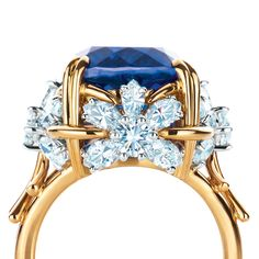 Tiffany & Co. Schlumberger® Four Flowers ring with a 11.24-carat tanzanite surrounded by diamonds in 18k gold and platinum. #TiffanyPinterest