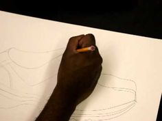 This video shoes teachers how they can implement their contour line drawing lesson by using shoes as an object to focus on