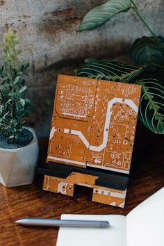 Keep your tech organized and fully charged in your home office with the ethically made Circuit Board Device Stand. This stand is handmade from upcycled circuit boards by artisans working with our fair trade partner Tara Projects.