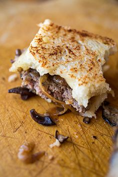 Cheese, caramelized onions and sauteed shiitake mushrooms on toasted sour dough bread