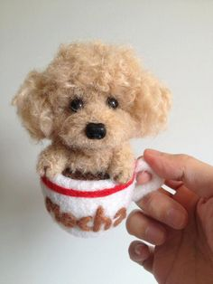 Needle wool felt Tea-cup Poodle in a coffee cup.