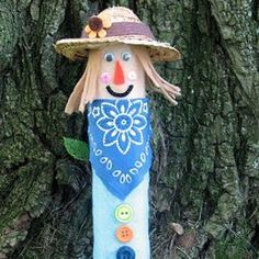 Cute! Craft a Sally the Scarecrow from recycled materials and use it as an autumn decoration!