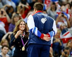 Kate Middleton is all smiles as she presents a gold medal. September 2, 2012