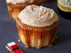 Tailgate Cupcakes are the holy trinity of salted caramel: salted caramel cake filled with yes, salted caramel, topped with salted caramel, and finished with a shower of crunchy coarse grained salt. In other words, perfect washed down with a beer. #recipe