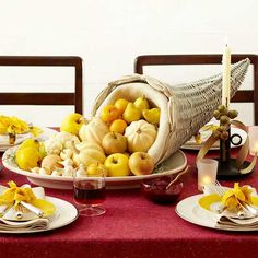 Create a classic cornucopia centerpiece this year! More Thanksgiving centerpieces: http://www.bhg.com/thanksgiving/indoor-decorating/pretty-thanksgiving-centerpieces/