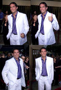 White suit, purple shirt.