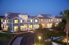 Coastal resort-style coach homes at twilight. Harbour Isle on Anna Maria Sound. New homes by Minto Communities in Bradenton, FL.
