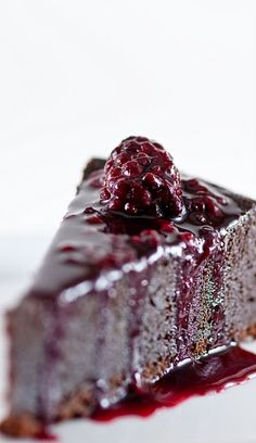 Chocolate Orbit Cake with Blackberry-Cassis Sauce.