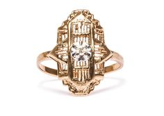 Dublin is a bold Art Deco ring made from 10K yellow gold centering a sweet bead set Round Brilliant Cut diamond in a geometric navette shaped setting. TrumpetandHorn.com | $500