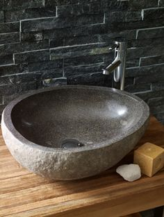Lavastone Pebble Basin from Mandarin Stone. These unique basins are carved from Basalt boulders found in the rivers of Indonesia. No two basins are alike and they vary in both size & shape, serving to create a singular look to your bathroom. #bathroom #basin #lavastone http://www.mandarinstone.com/products/bathware/lavastone_pebble_basin_limestone#
