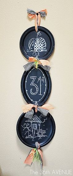 Dollar store silver platters made into chalkboards... with chalkboard paint!